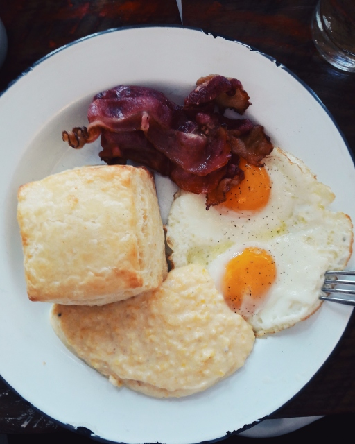 Eggs, bacon, biscuit and grits at Willa Jean's